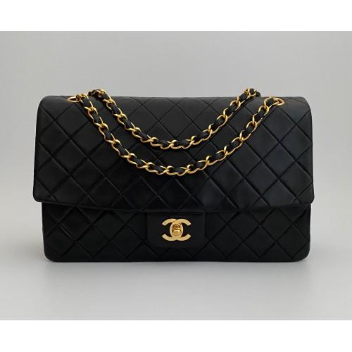Chanel flap bag black leather vintage...